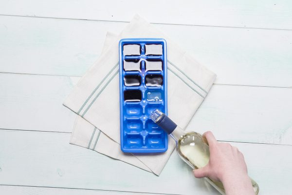 Wine being poured into an ice cube tray