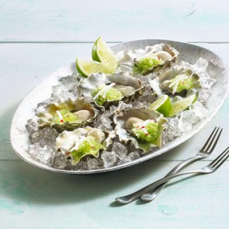 Oysters with cucumber-lime granita on a plate with ice
